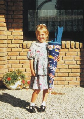 Me on my first day of school. In Germany you get a cone called a Schultüte - a big cardboard cone, prettily decorated and filled with toys, chocolate, candies, school stuff.